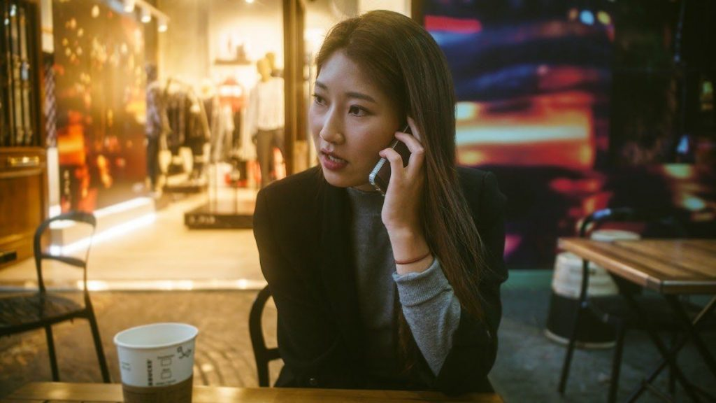 asian-woman-on-cellphone-in-coffeeshop