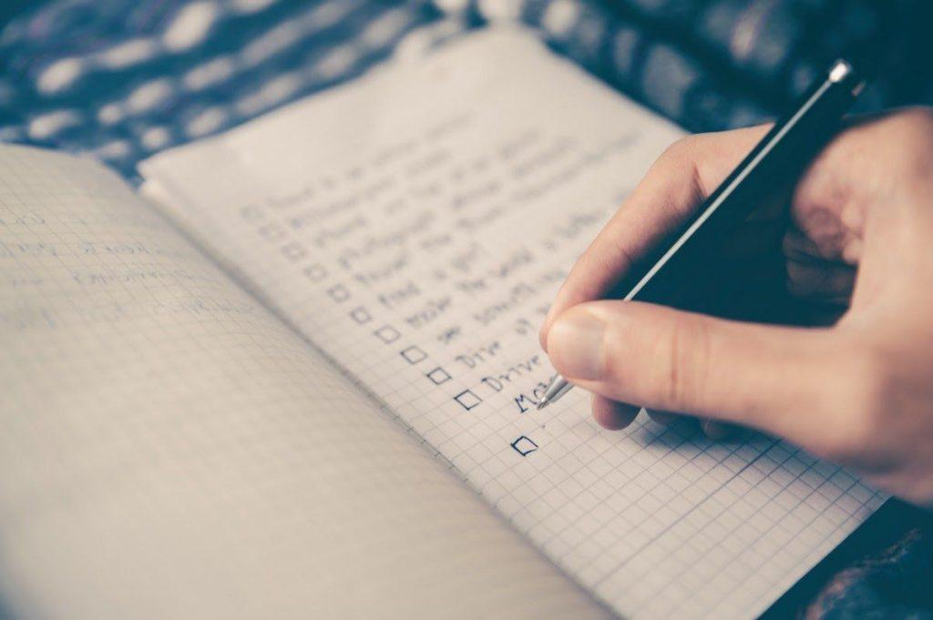 hand-writing-checklist-in-notebook-best-online-business-to-start